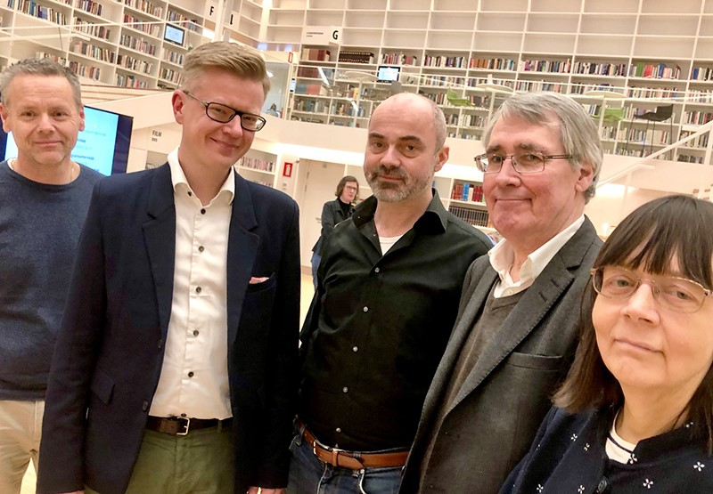 The five authors - four men and one woman - in the University Library at Campus Falun