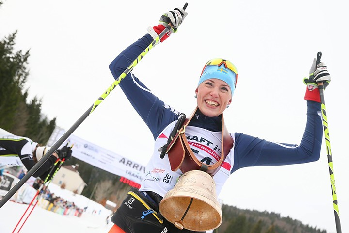 Maria Gräfning with her hands in the air cheering her victory.
