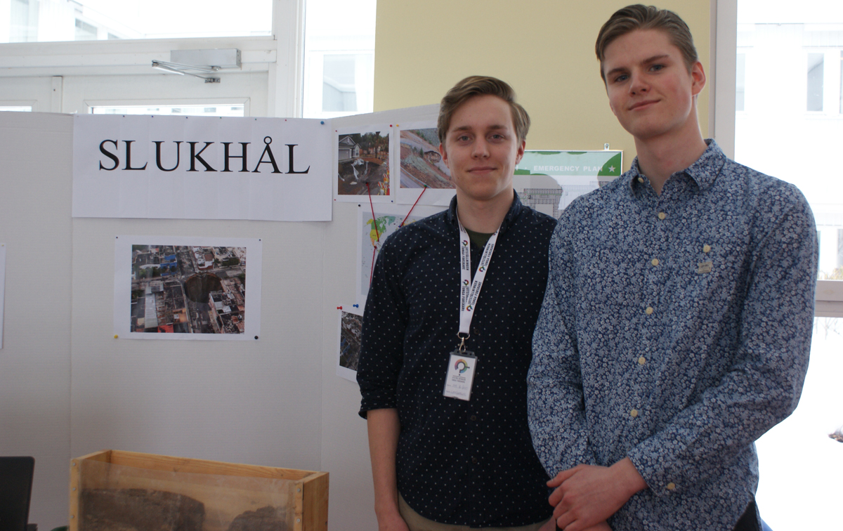 Two male pupils at their exhibition stand