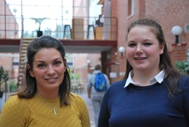 Two former female students standing at Campus Falun