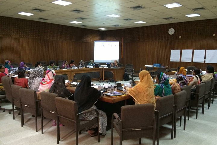 Group of student midwifery instructors seated in a meeting room