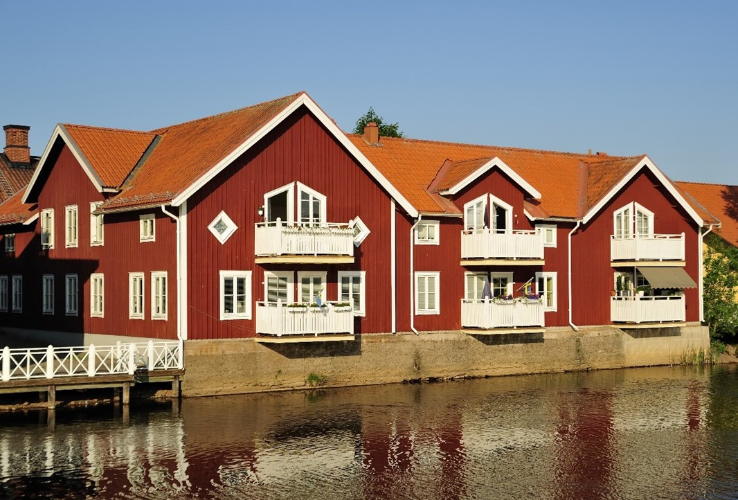 Red houses by the water