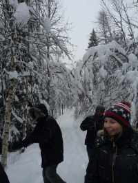 Students in snow-filled forest