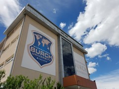 The image shows the Burch University logo on the side of the main building.